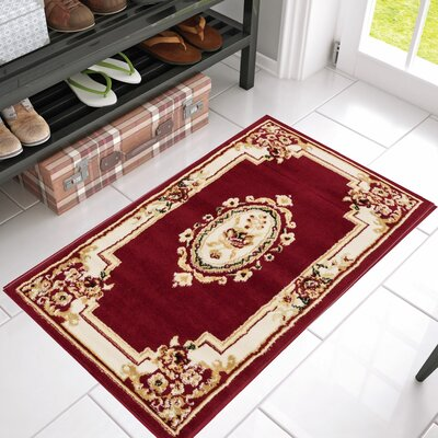 Coggrey Medallion Centre Red Area Rug Rug Size: 23 x 311