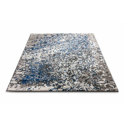 Angie Modern Abstract Paint Splash Blue Area Rug Rug Size: 33 x 47
