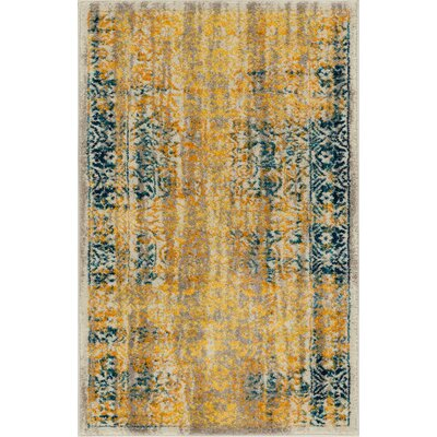 Binstead Traditional Medallion Distressed Power Loom Yellow Area Rug Rug Size: 710 x 910