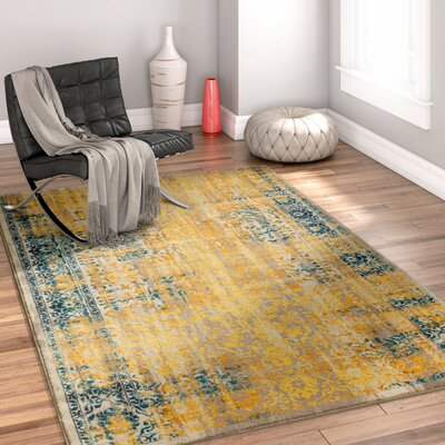 Binstead Traditional Medallion Distressed Power Loom Yellow Area Rug Rug Size: 311 x 57
