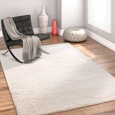 Dondre Vanilla Indoor Area Rug Rug Size: 67 x 910