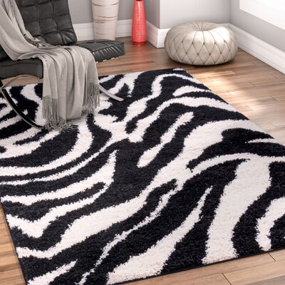 Dondre Black Indoor Area Rug Rug Size: 6'7'' x 9'10''