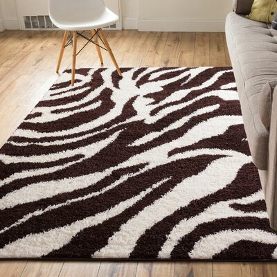 Dondre Brown Indoor Area Rug Rug Size: 5' x 7'2''