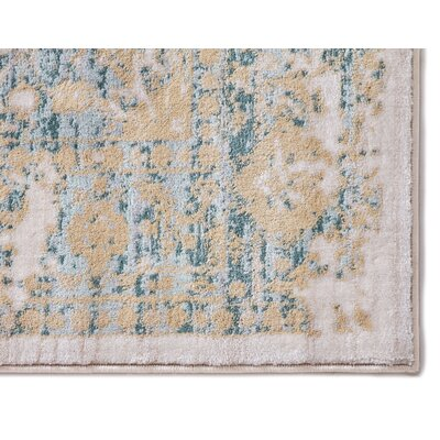 Aya Distressed Medallion Blue/Beige Area Rug Rug Size: 710 x 106