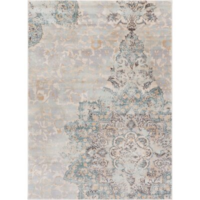 Aya Distressed Medallion Blue/Beige Area Rug Rug Size: 311 x 57