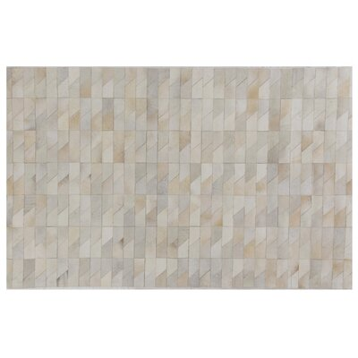 Natural Hide Hand Crafted Ivory/Natural Area Rug Rug Size: 5 x 8