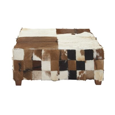 Wood Hide Cocktail Ottoman Upholstery Color: Black/Brown/White