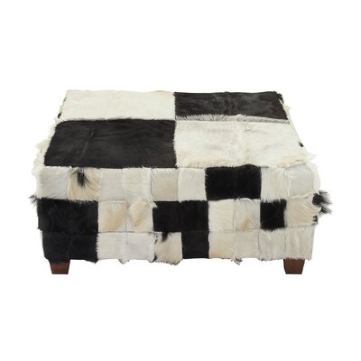 Wood Hide Cocktail Ottoman Upholstery Color: Black/White