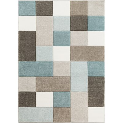 Mott Street Modern Geometric Carved Teal/Brown Area Rug Rug Size: 53 x 76