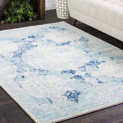 Downs Distressed Vintage Medallion White/Blue Area Rug Rug Size: 93 x 126