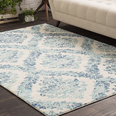 Everly Traditional Faded Oriental Blue/Beige Area Rug Rug Size: 2 x 3