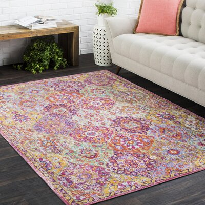 Kahina Vintage Distressed Oriental Rectangle Pink Area Rug Rug Size: 9 x 13