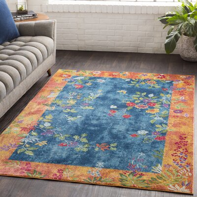 Lillo Vibrant Floral Blue/Burnt Area Rug Rug Size: Rectangle 7'10