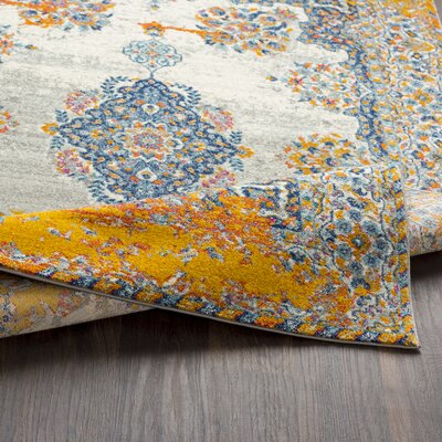 Leonardo Distressed Traditional Blue/Yellow Area Rug Rug Size: Rectangle 93 x 126