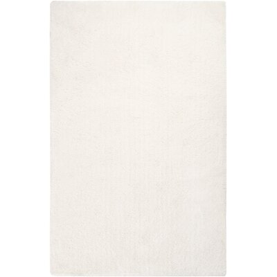 Braun Ivory Solid Area Rug Rug Size: 5 x 7