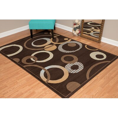Dallas Hip Hop Chocolate Area Rug Rug Size: 53 x 72