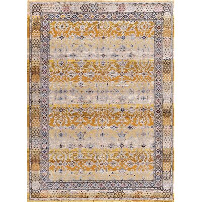 Signature Tan Area Rug Rug Size: 53 x 77