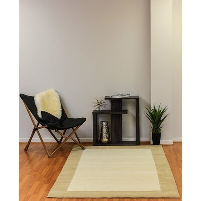 Manhattan Ivory Solid Bordered Area Rug Rug Size: Rectangle 5 x 8