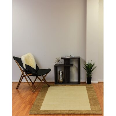 Manhattan Beige/Gold Solid Bordered Rug Rug Size: Rectangle 5 x 8