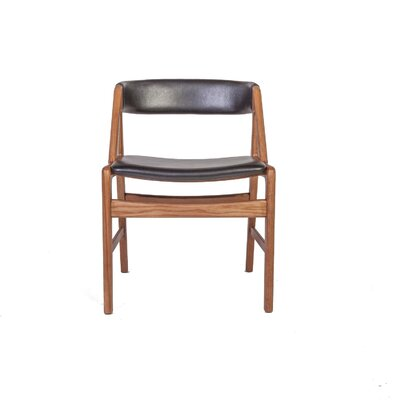 The Soen Genuine Leather Upholstered Dining Chair