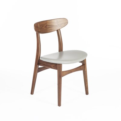 The Colborn Genuine Leather Upholstered Dining Chair