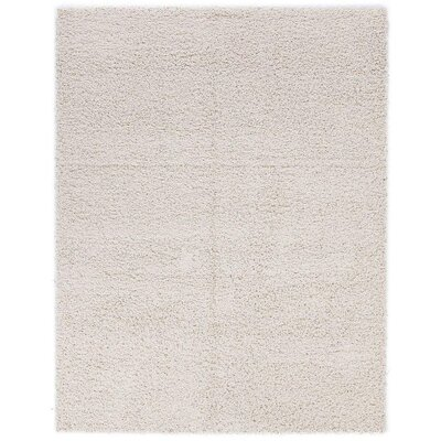 Cozy Cream Indoor/Outdoor Area Rug Rug Size: 67 x 93