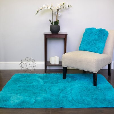 Hutton Cloud Plush Faux Fur Turquoise Area Rug