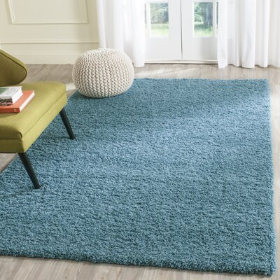 Acheson Turquoise Area Rug Rug Size: 67 x 96