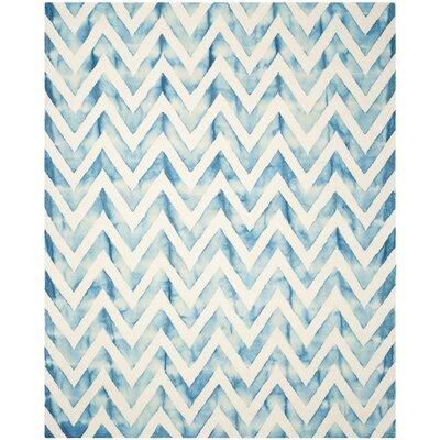 Crux Ivory/Turquoise Area Rug Rug Size: 9 x 12