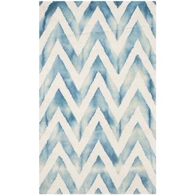Crux Ivory/Turquoise Area Rug Rug Size: 5 x 8