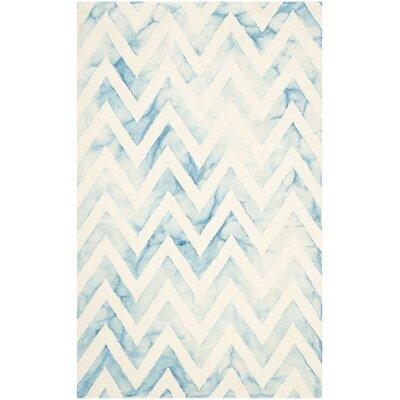 Crux Ivory/Turquoise Area Rug Rug Size: 6 x 9