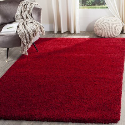 Brickner Red Area Rug Rug Size: Rectangle 67 x 96