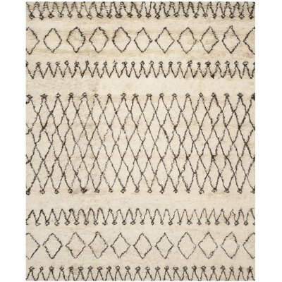 Gholston Tan/Brown Area Rug Rug Size: 10 x 14