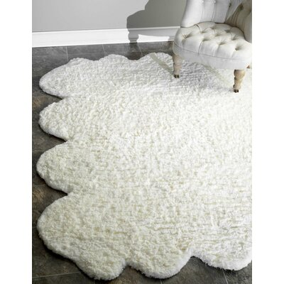 Bigby Faux Sheep Skin Hand Tufted Natural Area Rug