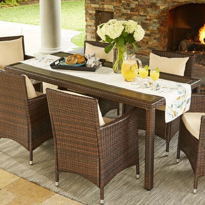 Lachesis Indoor/Outdoor Rectangle Dining Table Finish: Brown
