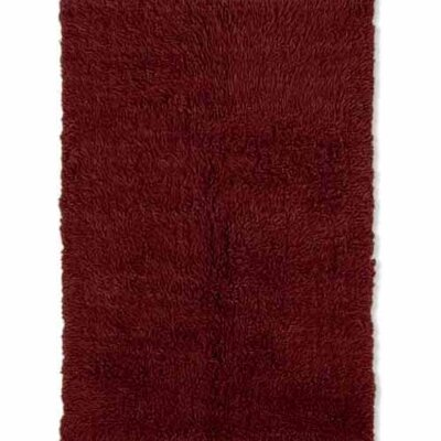 Carrico Flokati Hand-Woven Dark Red Area Rug Rug Size: 10 x 14
