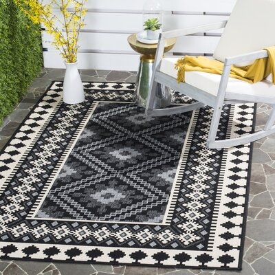 Tillis Black Outdoor Area Rug Rug Size: 53 x 77