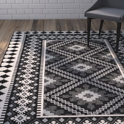 Tillis Black/Creme Outdoor Area Rug Rug Size: 67 x 96