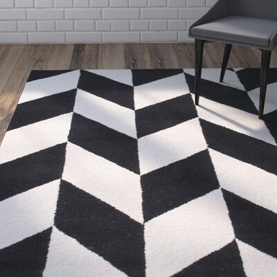 Rummel Hand-Tufted Black/White Indoor Area Rug Rug Size: 76 x 96
