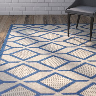 Felicity Navy Beige Indoor/Outdoor Area Rug Rug Size: 5 x 73