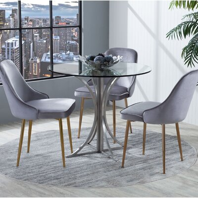 Seaberg Dining Table Finish: Stainless Steel
