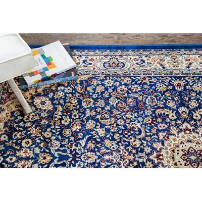 Royal Palm Traditional Blue/Brown Area Rug Rug Size: 5 x 7