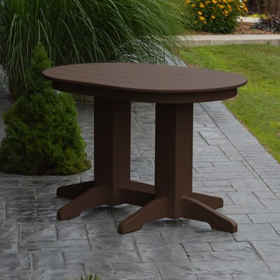 Nettie Dining Table Color: Tudor Brown, Table Size: 60 L x 33 W