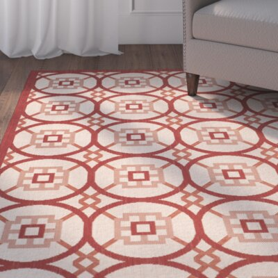 Caboose Beige/Red Indoor/Outdoor Area Rug Rug Size: 67 x 96
