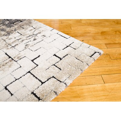 Claudia Taupe Area Rug Rug Size: 710 x 910