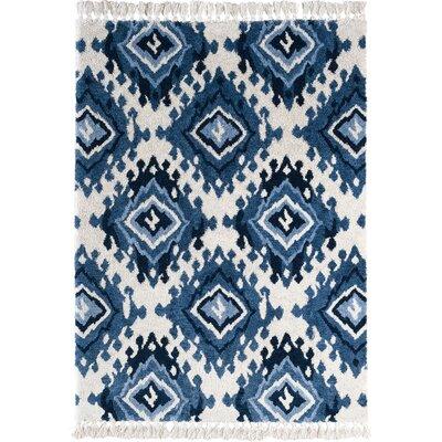 Shuster Ivory/Indigo/Blue Area Rug Rug Size: 76 x 96