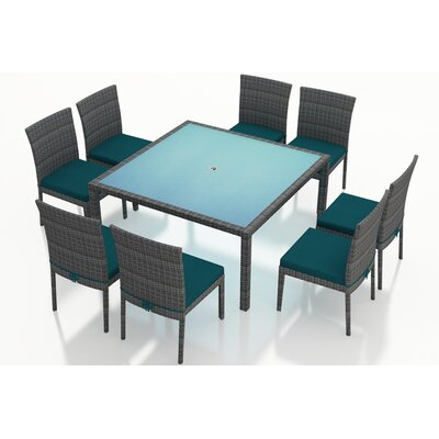 Gerron 9 Piece Dining Set with Cushions Fabric: Spectrum Peacock