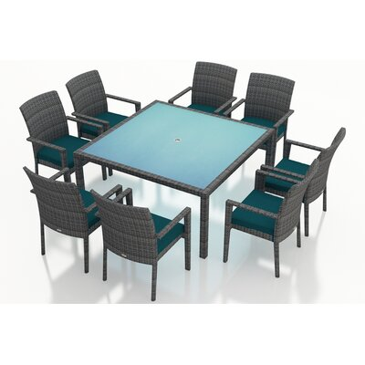 Gerron 9 Piece Wicker Dining Set with Cushions Fabric: Spectrum Peacock