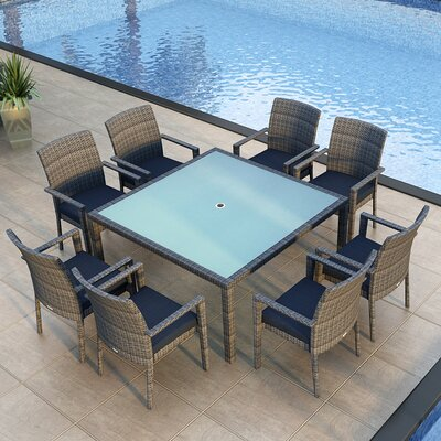 Gerron 9 Piece Wicker Dining Set with Cushions Fabric: Spectrum Indigo