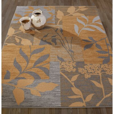 Anne Floral Patchwork Gold/Blue Area Rug Rug Size: 5 x 66